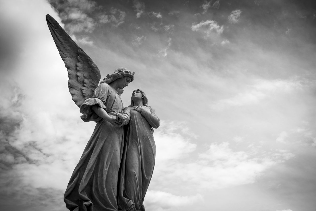 An angel holding a woman